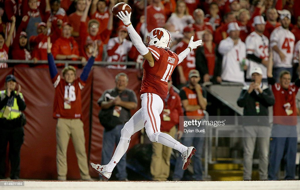 Jazz Peavy #11 of the Wisconsin Badgers scores a touchdown in the first quarter against the Ohio State Buckeyes at Camp Randall Stadium on October 15, 2016 in Madison, Wisconsin.