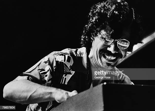Jazz pianist Chick Corea plays an electronic keyboard that is reflected in his glasses in this 1980 Los Angeles California concert photo
