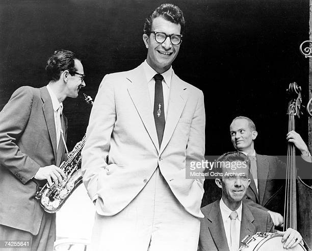 Jazz pianist Dave Brubeck poses for a portrait with the Dave Brubeck Quartet which included Paul Desmond on saxophone Lloyd Davis on drums and Ron...