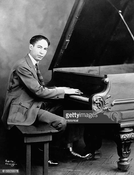 Jazz pioneer Jelly Roll Morton plays the piano