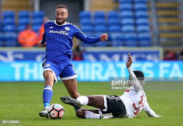 Jazz Richards of Cardiff City is tackled by Dennis Adeniran of Fulham during the The Emirates FA Cup 3rd Round match between Cardiff City and Fulham...