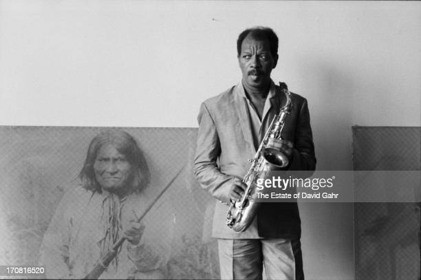 Jazz saxophonist and composer Ornette Coleman poses for a portrait with his saxophone at his home on May 28 1986 in New York City New York