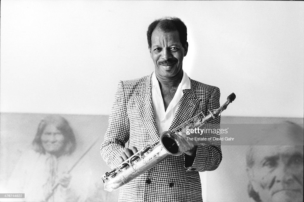 Jazz saxophonist and composer Ornette Coleman poses for a portrait with his saxophone at his home on May 28, 1986 in New York City, New York.