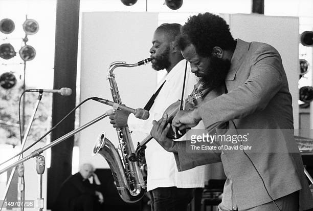 Jazz saxophonist Dewey Redman and bandleader composer and musician Ornette Coleman perform as the Ornette Coleman Quartet at the Newport Jazz...
