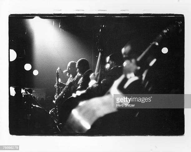 Jazz saxophonist John Coltrane performs onstage with band member Eric Dolphy in 1961 in New York City New York