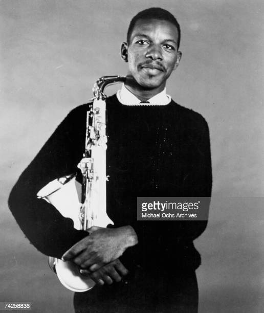 Jazz saxophonist Ornette Coleman poses for a portrait holding his saxophone in circa 1959
