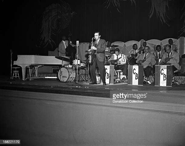 Jazz saxophonist Stan Getz plays onstage with a the Brooklyn Paramount with the Count Basie Orchestra on March 5 1955 in New York New York