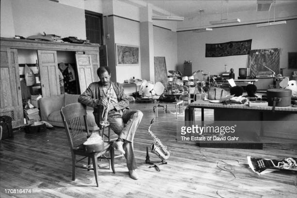 Jazz saxophonist trumpeter and composer Ornette Coleman poses for a portrait while rehearsing his trumpet at home on June 19 1986 in New York City...