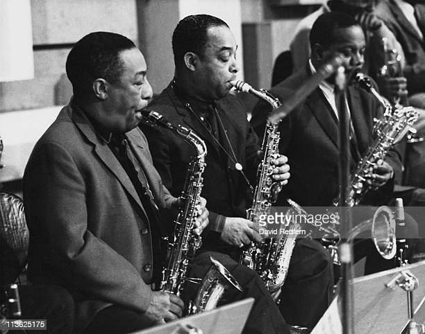 US jazz saxophonists Johnny Hodges and Harry Carney playing their saxophones with Duke Ellington's orchestra circa 1965