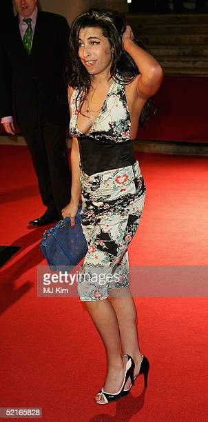 Jazz singer Amy Winehouse arrives at the 25th Anniversary BRIT Awards 2005 at Earl's Court February 9 2005 in London