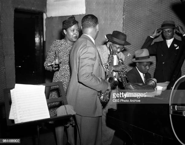 Jazz singer Billie Holiday and band at recording session From left to right Billie Holiday Jimmy Powell Roy Eldridge Sonny White John Williams New...