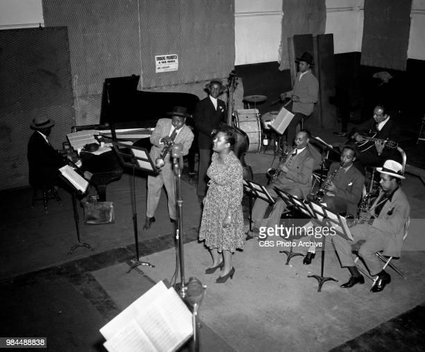Jazz singer Billie Holiday and band at recording session New York NY Left to right Sonny White Roy Eldridge John Williams Billie Holiday Hal West...
