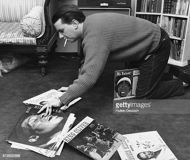 Jazz singer George Melly shows off his collection of records