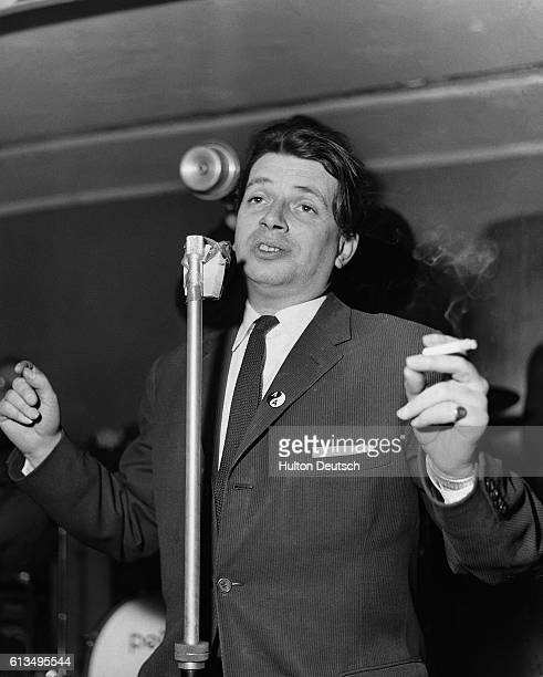 Jazz singer George Melly sings the blues during a performance at a night club with the Mick Mulligan Jazz Combo