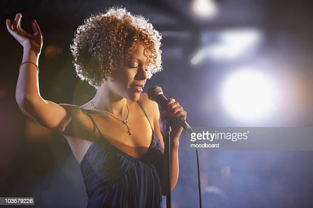 jazz singer on stage, portrait - singer stock pictures, royalty-free photos & images