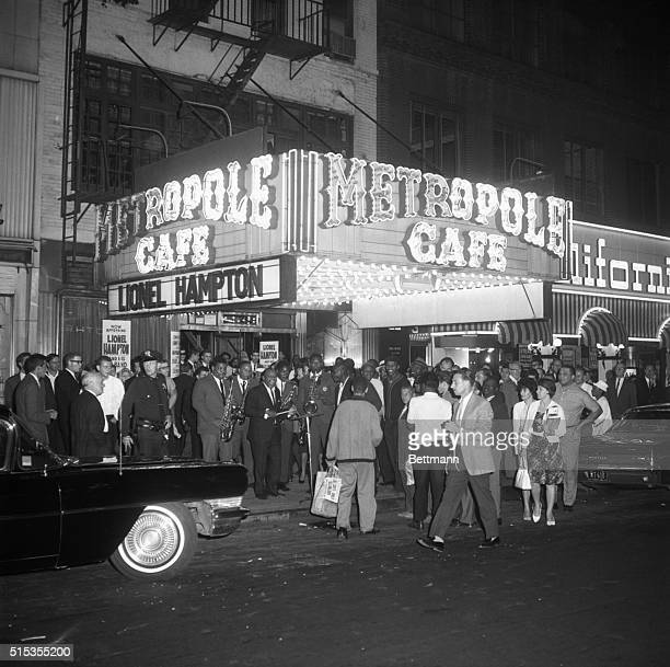 Jazz star Lionel Hampton and his 16piece band play for New Yorkers at the door of the Metropole Cafe to celebrate his 1000th royalty check for his...
