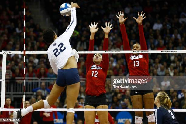 Jazz Sweet and Briana Holman of the University of Nebraska jump for a block against Simone Lee of Penn State University during the Division I Women's...