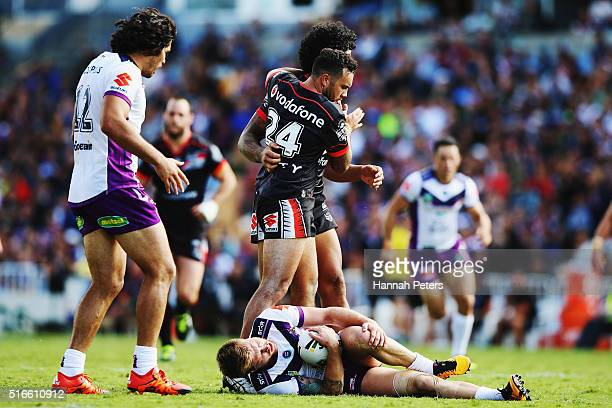 Jazz Tevaga of the Warriors congratulates James Gavet of the Warriors after a tackle on Cameron Munster of the Melbourne Storm during the round three...