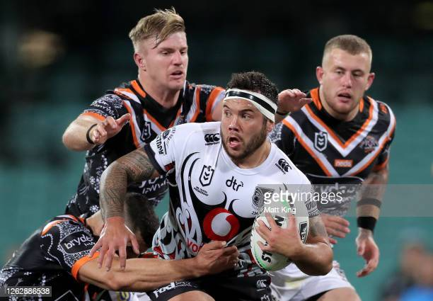 Jazz Tevaga of the Warriors is tackled during the round 12 NRL match between the Wests Tigers and the New Zealand Warriors at the Sydney Cricket...