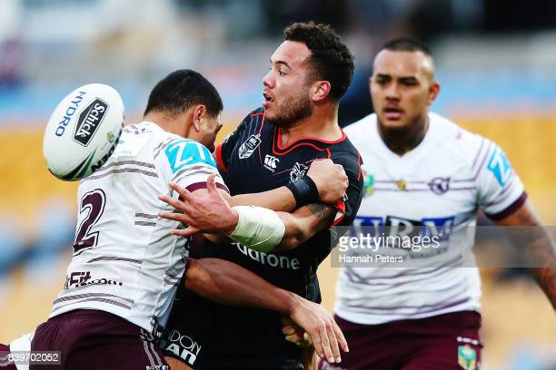Jazz Tevaga of the Warriors offloads the ball during the round 25 NRL match between the New Zealand Warriors and the Manly Sea Eagles at Mt Smart...