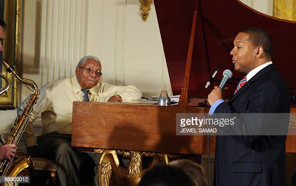 Jazz trumpet player Wynton Marsalis and his father pianist Ellis Marsalis talk during a jazz workshop for students hosted by first lady Michelle...