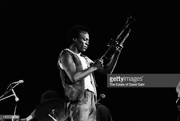 Jazz trumpeter and composer Miles Davis performs in August 1970 at the Tanglewood Music Festival in Lenox Massachusetts