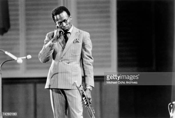 Jazz trumpeter and composer Miles Davis plays trumpet as he performs onstage in circa 1959 in West Germany