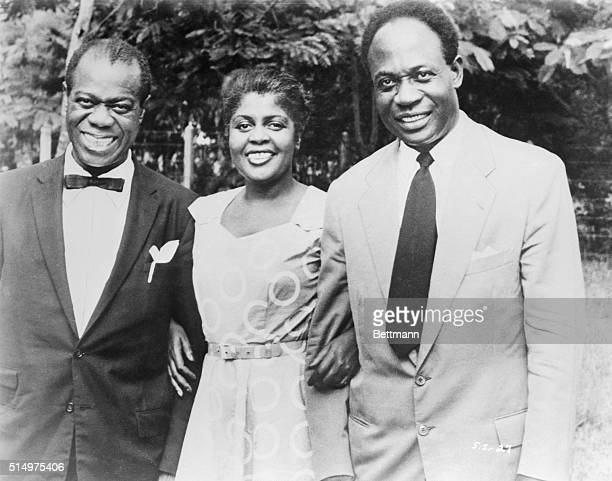 Jazz trumpeter Louis Armstrong and his wife Lucille were greeted by Ghana Prime Minister Kwame Nkrumah during Armstrong's tour of Europe and Africa...