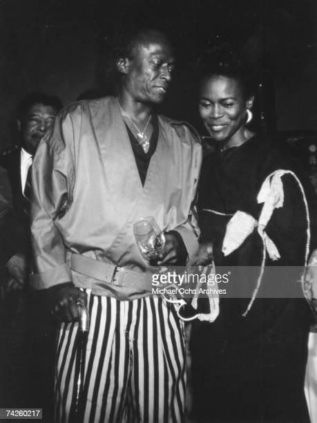 Jazz trumpeter Miles Davis attends his birthday party with wife actress Cicely Tyson on May 26 1984