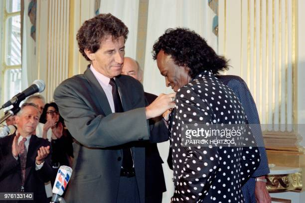 US jazz trumpeter Miles Davis is made a Knight in the French Legion of Honor by French Culture minister Jack Lang in Paris on July 16 1991