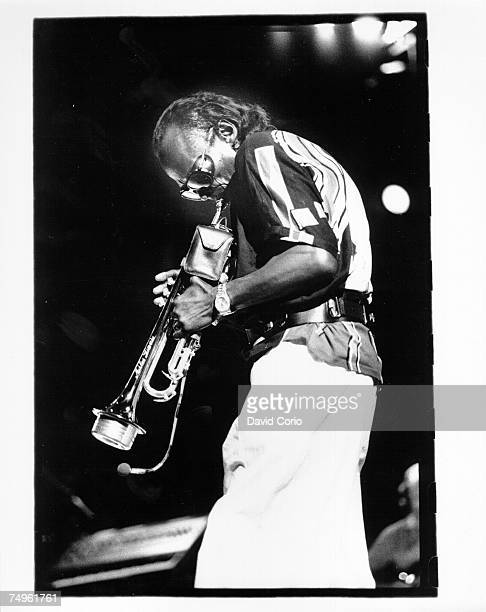 Jazz trumpeter Miles Davis performs onstage in circa 1984 in England