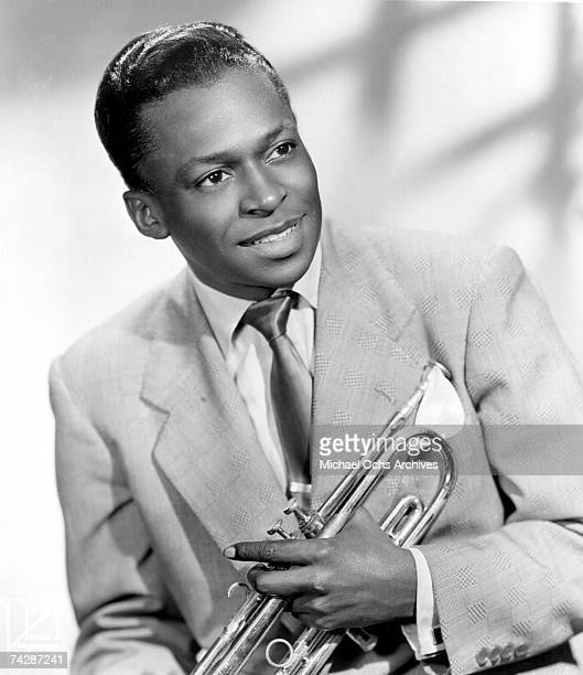 Jazz trumpeter Miles Davis poses for a portrait early in his career holding his horn in 1948 in New York City New York