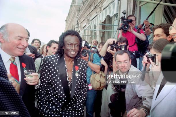 US jazz trumpeter Miles Davis smiles among the crowd after the ceremony which made him a Knight in the French Legion of Honor by French Culture...