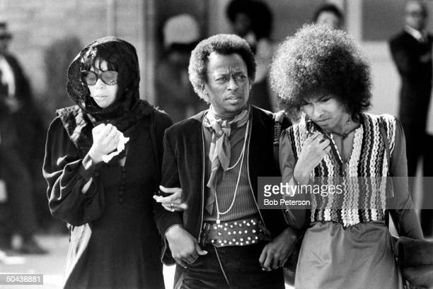Jazz trumpeter Miles Davis w his singer wife Betty Mabry an unident woman arriving at the funeral of rock guitarist Jimi Hendrix