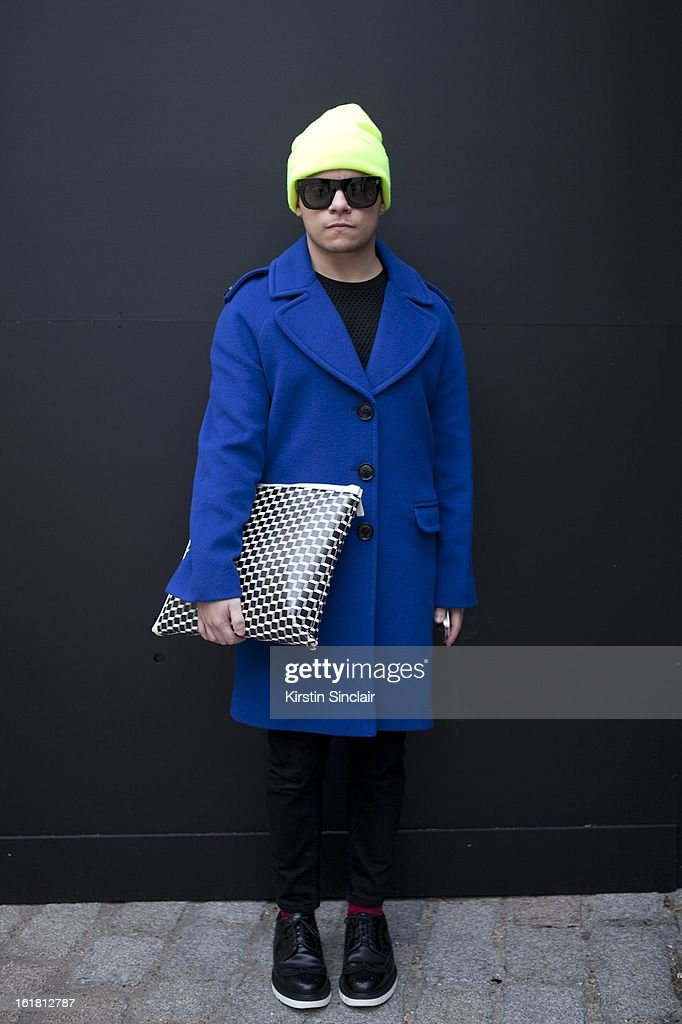 Jazzino Tamani writerfor 1883 wearing American Apparel hat, H&M glasses, Jaeger coat, Aqua by Aqua top, Pierre Hardy bag, Top Man shoes and trousers, on day 2 of London Womens Fashion Week Autumn/Winter 2013 on February 16, 2013 in London, England.