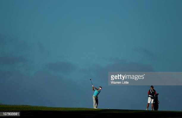 Jbe Kruger of South Africa plays his second shot into the 15th green during the first round of the Africa Open at East London GC on January 6 2011 in...