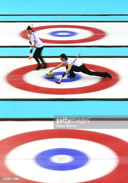 JCarmen Kueng of Switzerland plays a stone during the Bronze medal match between Switzerland and Great Britain on day 13 of the Sochi 2014 Winter...