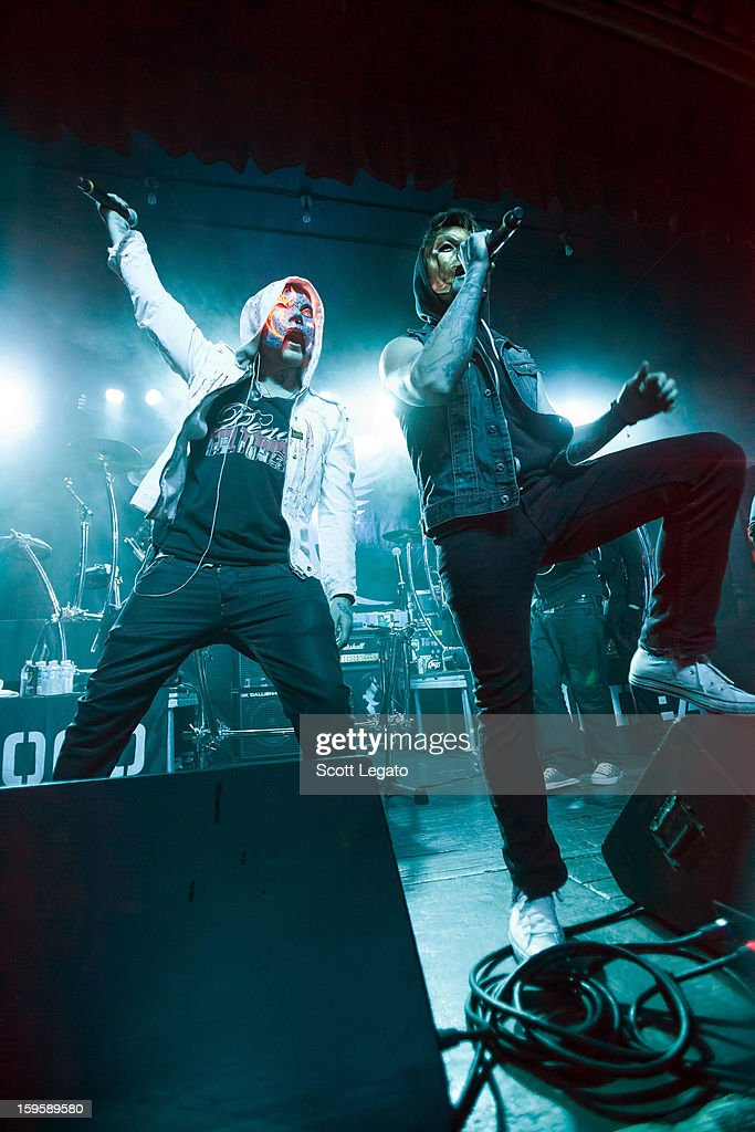 J-Dog (L) and Danny of Hollywood Undead performs in concert at St. Andrew's Hall on January 16, 2013 in Detroit, Michigan.