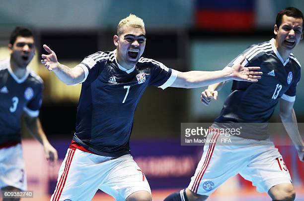 Jdolfo Salas and Enrique Franco celebrate as Paraguay win a penalty shoot out during the FIFA Futsal World Cup Round of 16 match between Colombia and...
