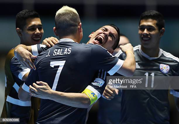 Jdolfo Salas of Paraguay celebrates with Juan Salas of Paraguay as Paraguay win a penalty shoot out during the FIFA Futsal World Cup Round of 16...