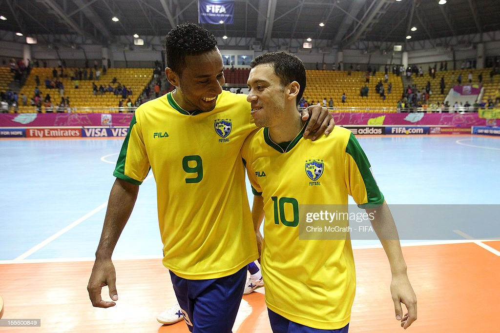 Je #9 of Brazil and team mate Fernandinho #10 celebrate victory over Libya during the FIFA Futsal World Cup, Group C match between Brazil and Libya at Korat Chatchai Hall on November 4, 2012 in Nakhon Ratchasima, Thailand.