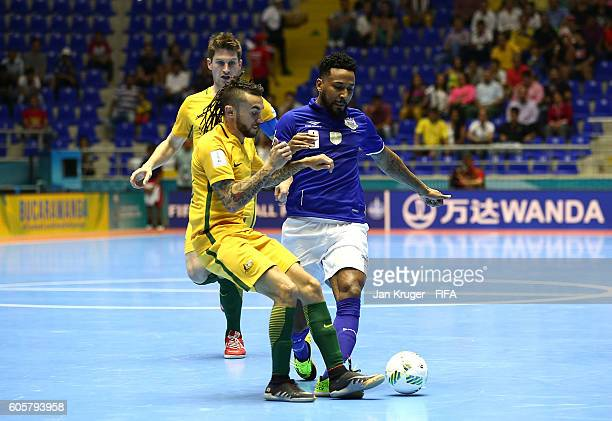 Je of Brazil battles with Daniel Fogarty of Australia during the FIFA Futsal World Cup Group D match between Australia and Brazil at Coliseo...