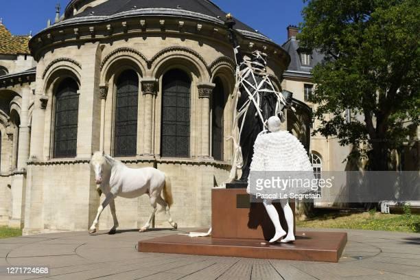 """Jeade Pasquier, La commedia character and a horse perform for the """"Il Medico Della Peste"""" 2020/2021 Winter Franck Sorbier Haute Couture Maitre..."""