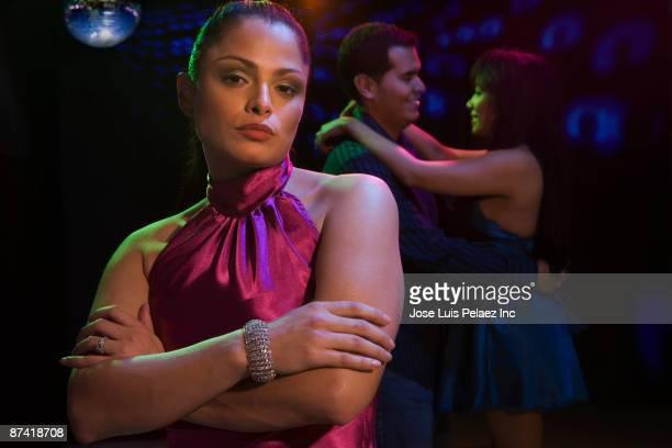 Jealous Hispanic woman in nightclub
