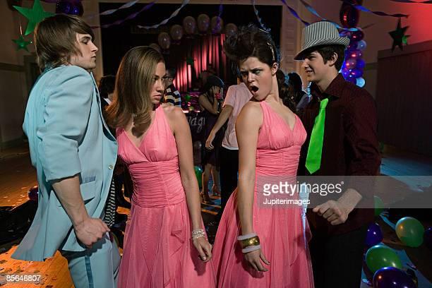Jealous teenage girls wearing same dress at prom