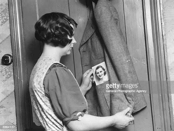 A jealous wife finds a photograph of her cheating husband's sweetheart