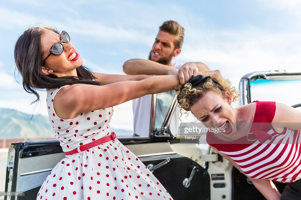 Jealous Woman Attacks Another Woman Over a Man : Stock Photo