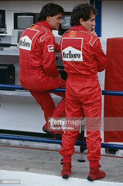 Jean Alesi and team mate Alain Prost of France drivers of the and Scuderia Ferrari SpA Ferrari 643 Ferrari V12's during practice for the Portuguese...