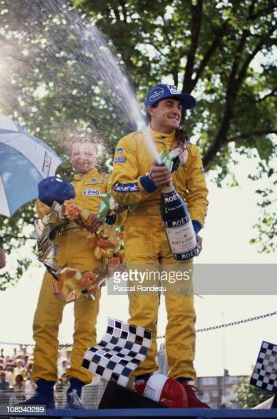 Jean Alesi driver of the Eddie Jordan Racing Reynard 89D Mugen celebrates by spraying champagne after winning the FIA International F3000...