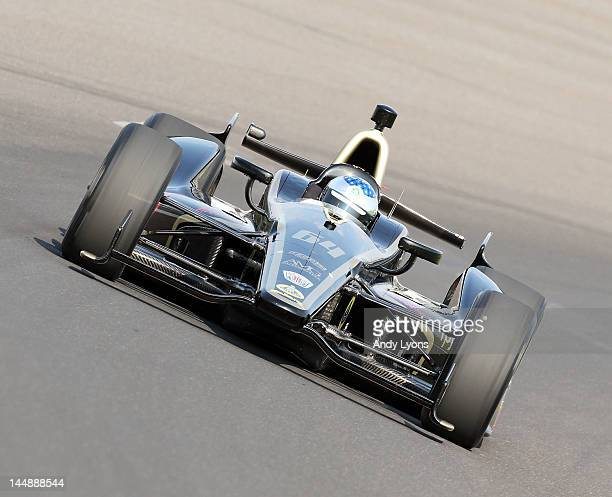 Jean Alesi drives the Lotus FP Journe Fan Force United car during practice for the Indinapolis 500 at Indianapolis Motor Speedway on May 20 2012 in...